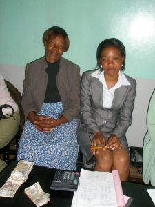 Two female microfinance borrowers: Rose, right, with Bright Vision's treasurer Elizabeth