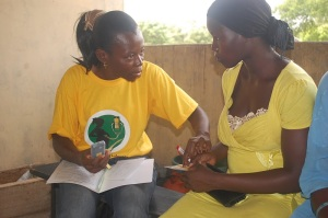 A Mobile Midwife counselor talks with a client