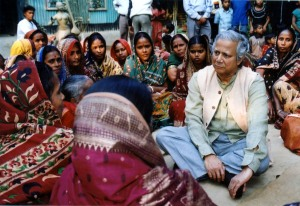 Professor Muhammad Yunus listens to some of Grameen Bank's borrower-owners at a local Center meeting.
