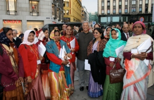Prof. Yunus and most of the Board directors who represent the borrower-owners of Grameen Bank tour the streets of Oslo the day before receiving the Nobel Peace Prize in 2006.