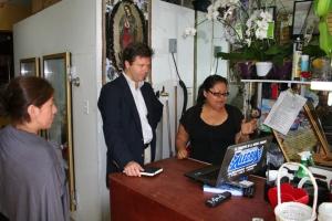 Sabrina Dominguez shows Alex Counts her flower business. (Photo by   H.A. Shah Newaz.)