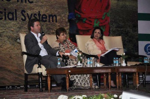Grameen Foundation President and CEO Alex Counts (lefts) speaks about the Indian microfinance sector at the Sa-Dhan Conference held earlier this month in that country. With him on stage are Jayshree Vyas (center), Managing Director of SEWA Bank, who served as the moderator, and Sujata Lamba of the World Bank.