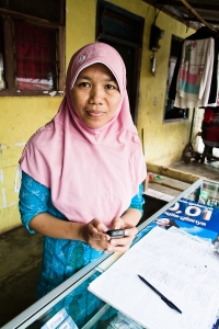 "In Indonesia, ""mobile microentrepreneurs"" like the one pictured here are already helping other poor people in their community find jobs and get information on market prices for their goods."